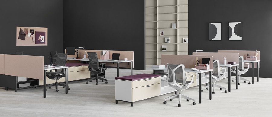 Two Canvas Storage workstations with pink screens, lower storage with purple cushion tops, and Cosm office chairs.