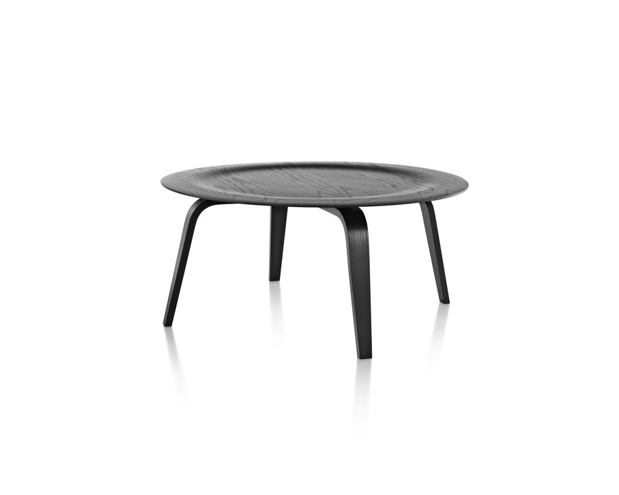 A round Eames Molded Plywood Coffee Table with wood legs and an indented top in a black finish.