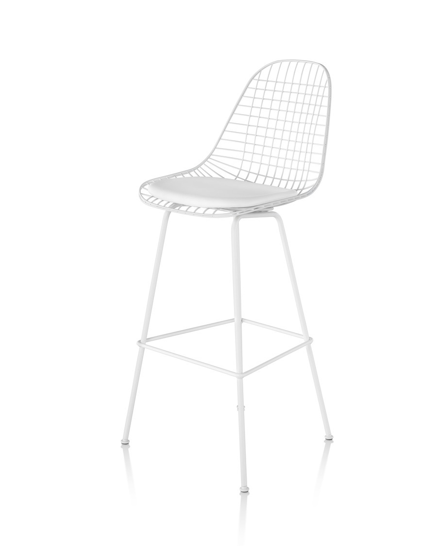 Front angled view of a white Eames Wire Stool with a white seat pad