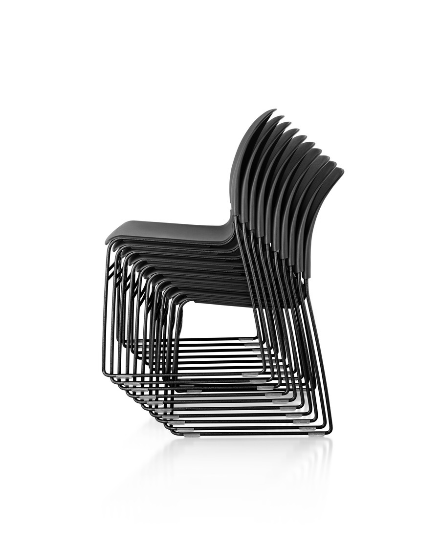 Group of black Limerick Chairs stacked on top of one another, viewed from the side