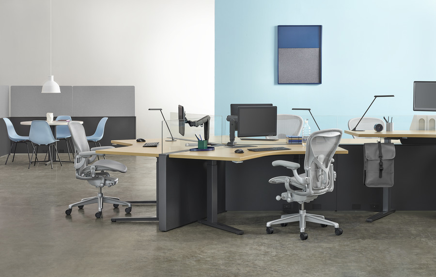 A Canvas Channel workstation with Renew height-adjustable tables and light grey Aeron office chairs.