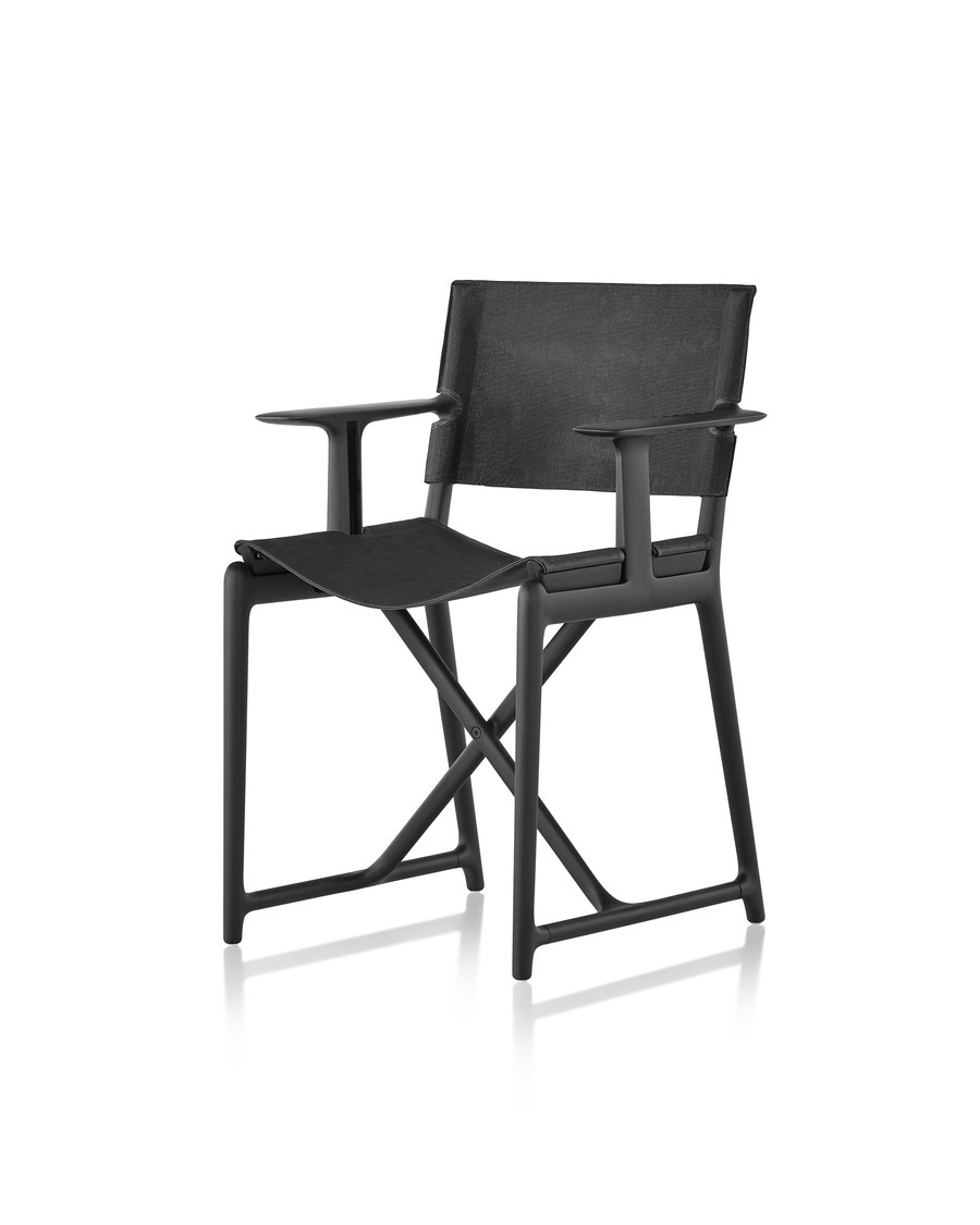 A black Magis Stanley director's chair, viewed at a 45 degree angle