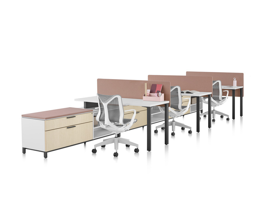 A Canvas Storage workstation with white surfaces, pink screens, and grey Cosm office chairs.