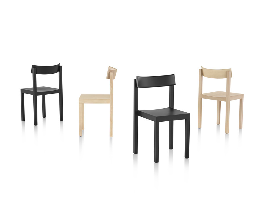 Four Mattiazzi Primo stacking chairs in black and light wood finishes viewed from various angles.