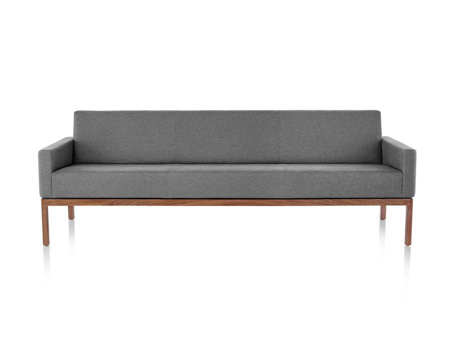 Wood Base Lounge Seating sofa with dark wood base, upholstered with gray fabric, viewed from the front