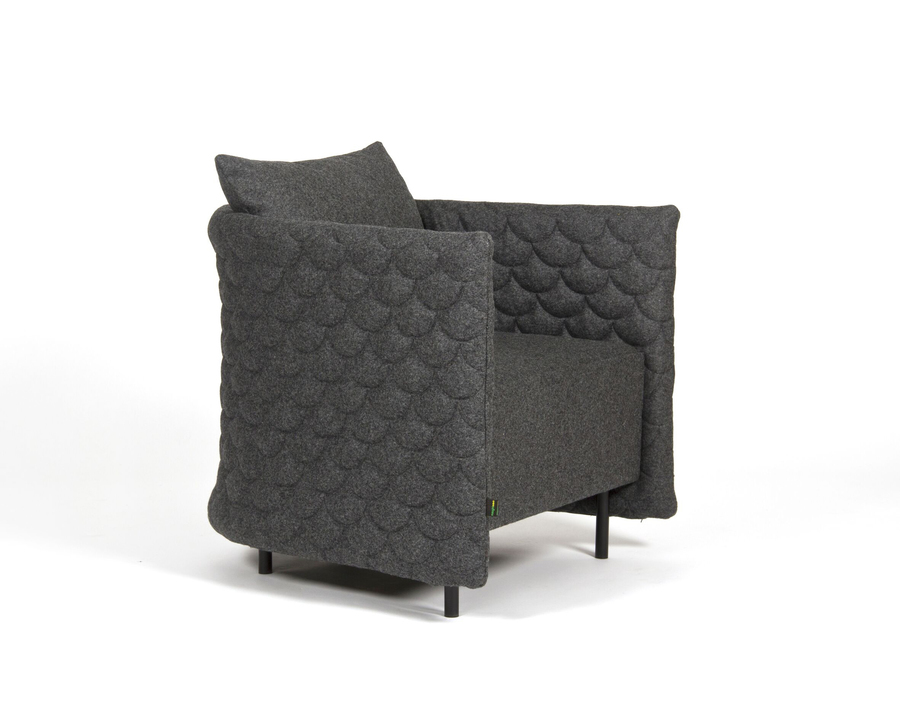 A dark gray naughtone Cloud Quilt Armchair, viewed from an angle.
