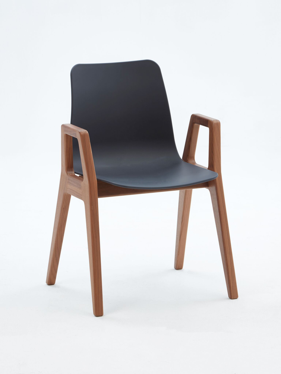 A black naughtone Polly Wood Chair with an oak base and armrests, viewed from an angle