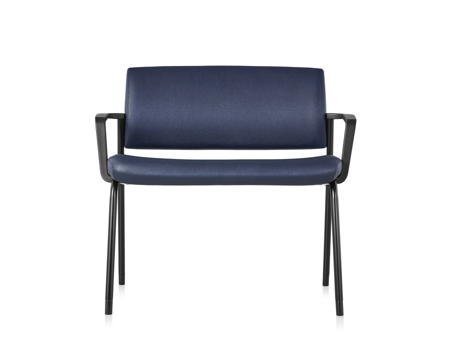 Front view of a Verus Plus Chair with arms upholstered in blue vinyl.