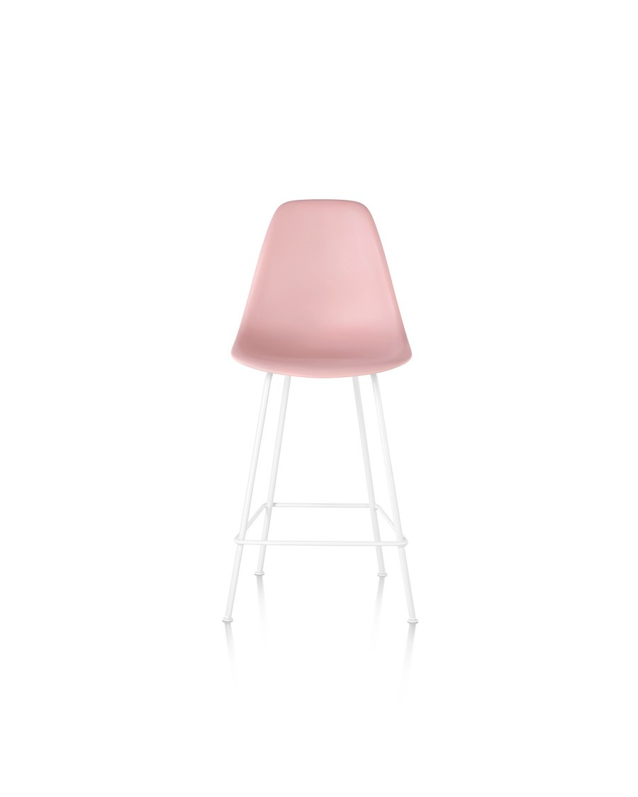 Front view of a light pink Eames Molded Plastic Stool and a white base.