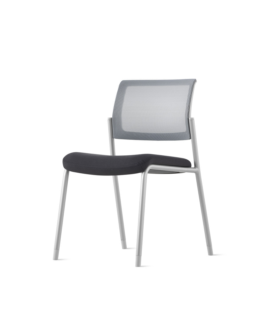 A gray Verus Side Chair upholstered in black with white suspension back and no arms at an angle.