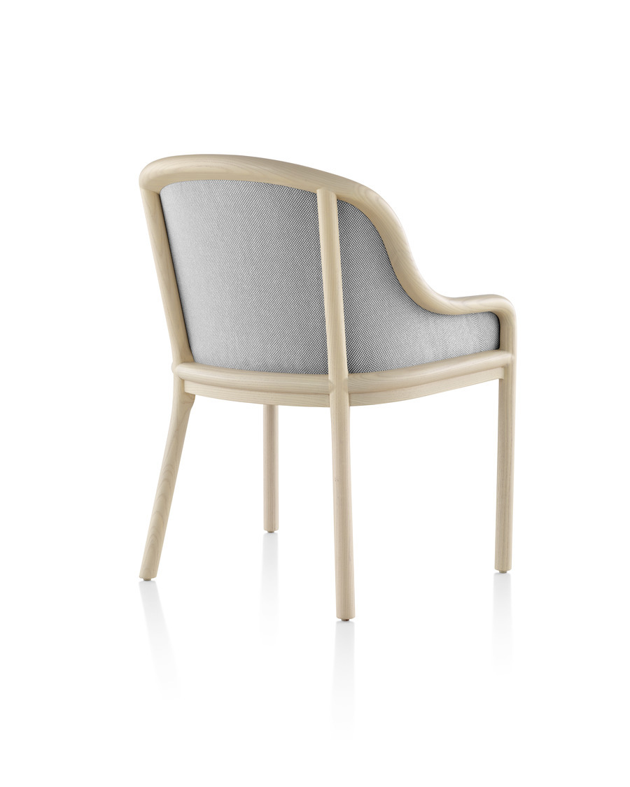 Landmark Chair with light gray upholstery and a light wood frame, viewed at a 45 degree rear view