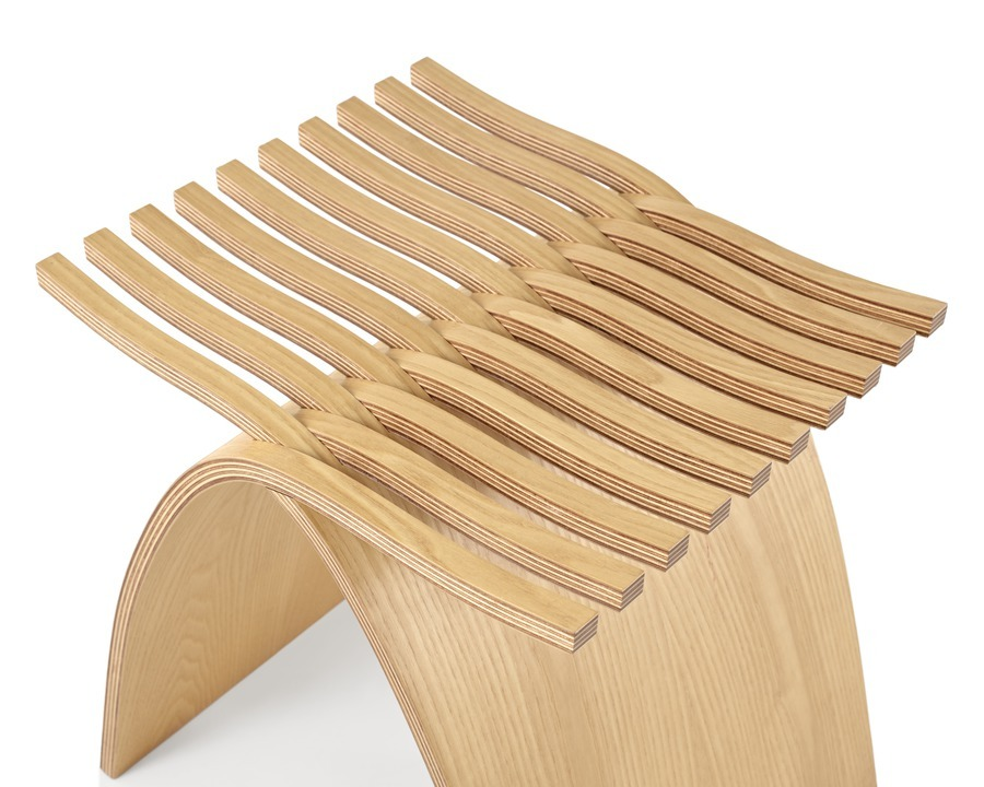 A close up of the seat of a molded plywood Capelli Stool with a light ash veneer, viewed from above