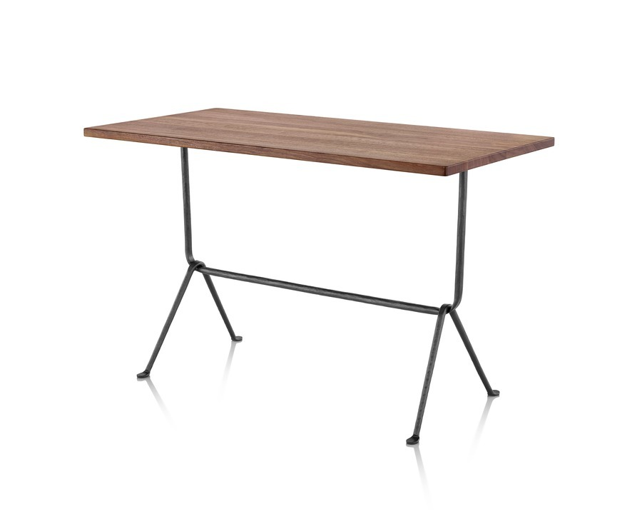 A rectangular Magis Officina Table with a medium veneer top and wrought iron legs, viewed from a 45-degree angle.