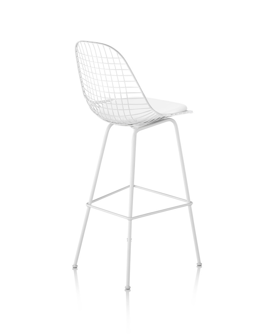 Rear view of a white Eames Wire Stool