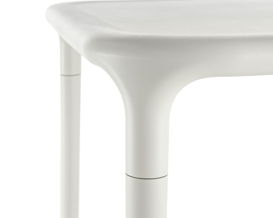 Close up image of a corner of white Magis Air Table