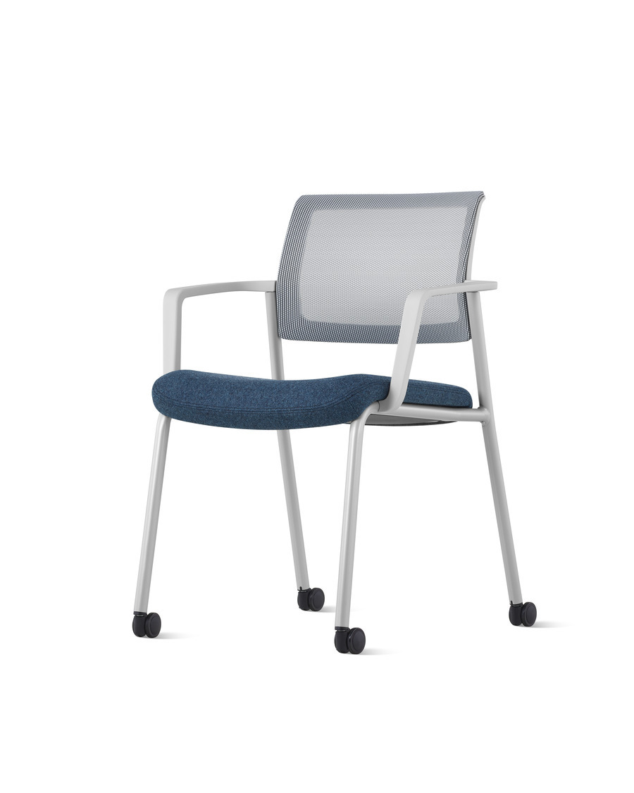Front angled view of a Verus Side Chair upholstered in blue with white suspension back and arms.