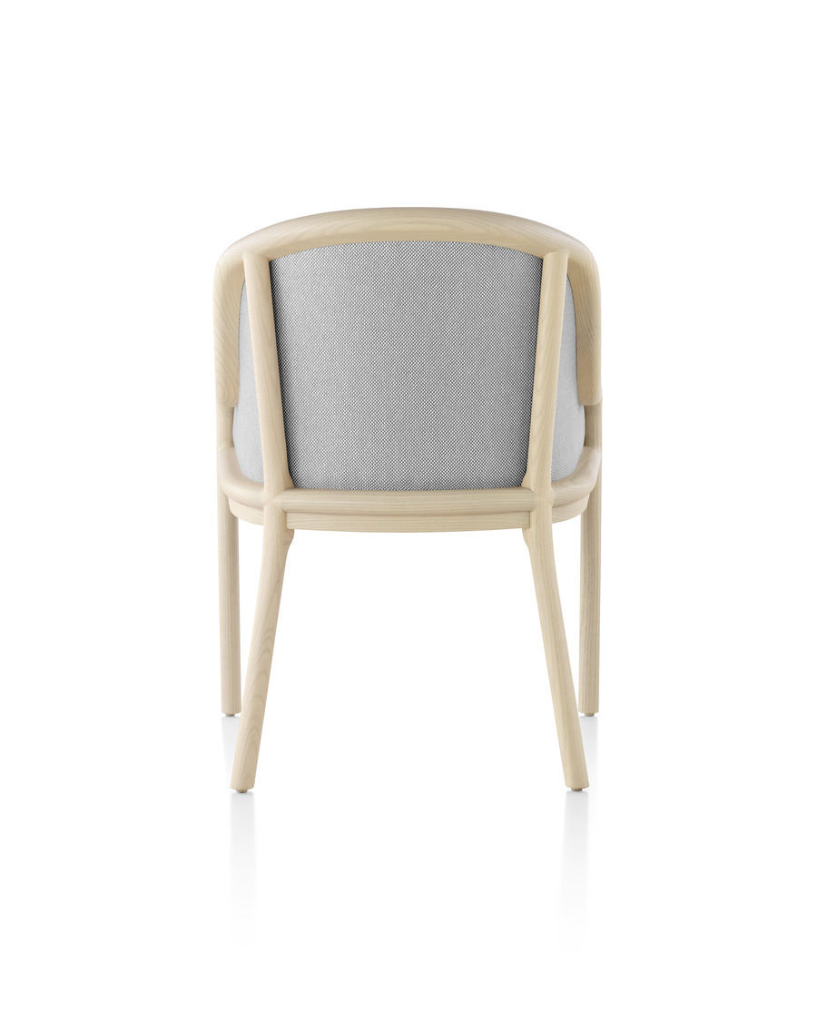 Landmark Chair with light gray upholstery and a light wood frame, viewed from the rear