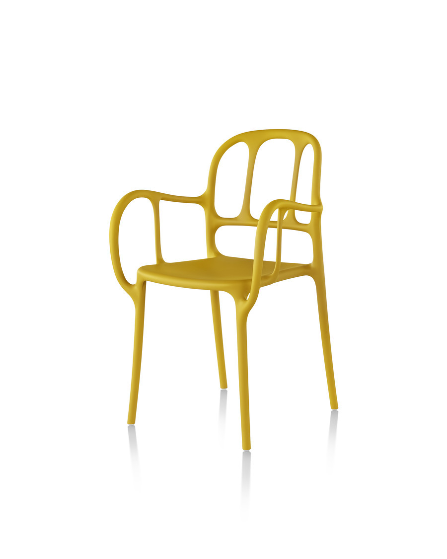 Yellow Magis Milà side chair, viewed from a 45-degree angle.