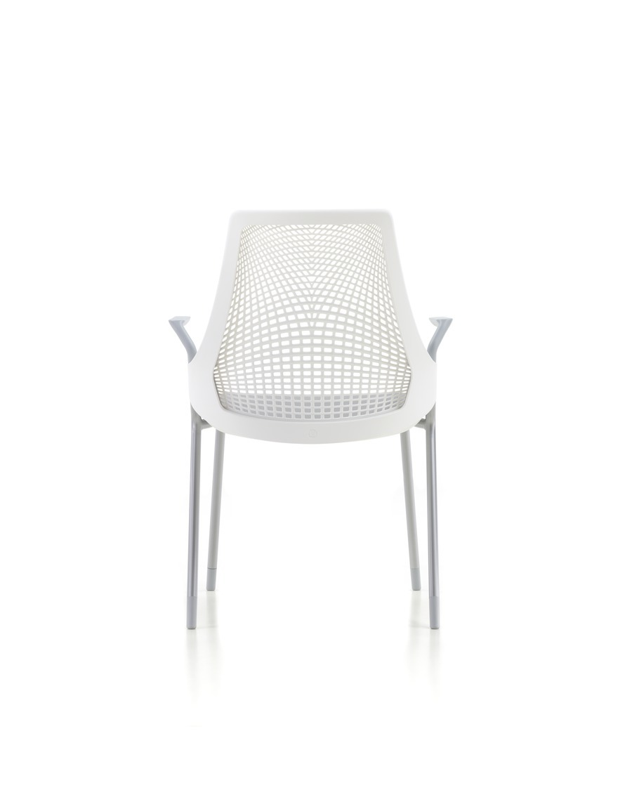 Rear view of a four-leg white Sayl Side Chair, showing the suspension back