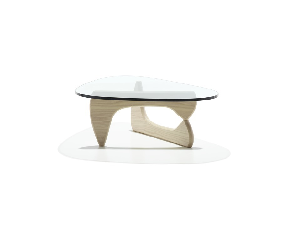 A Noguchi occasional table with a freeform glass top and white ash base.