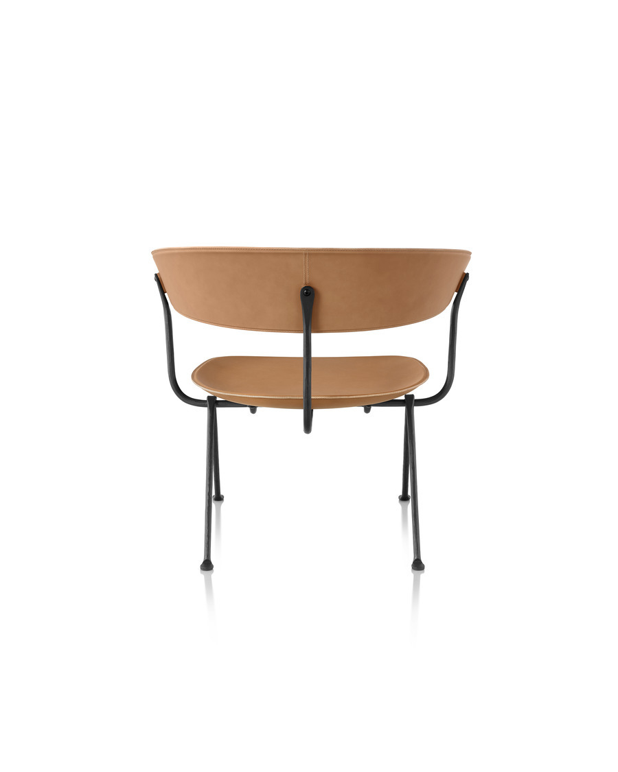Magis Officina Low Chair in natural leather, viewed from the rear