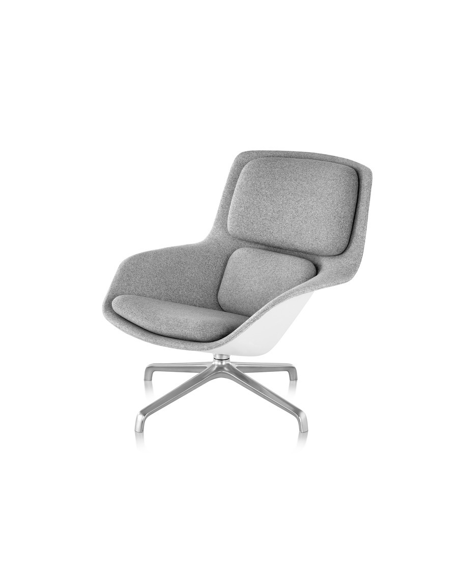 Grey low-back Striad Lounge Chair with chrome four-star base, viewed at an angle.