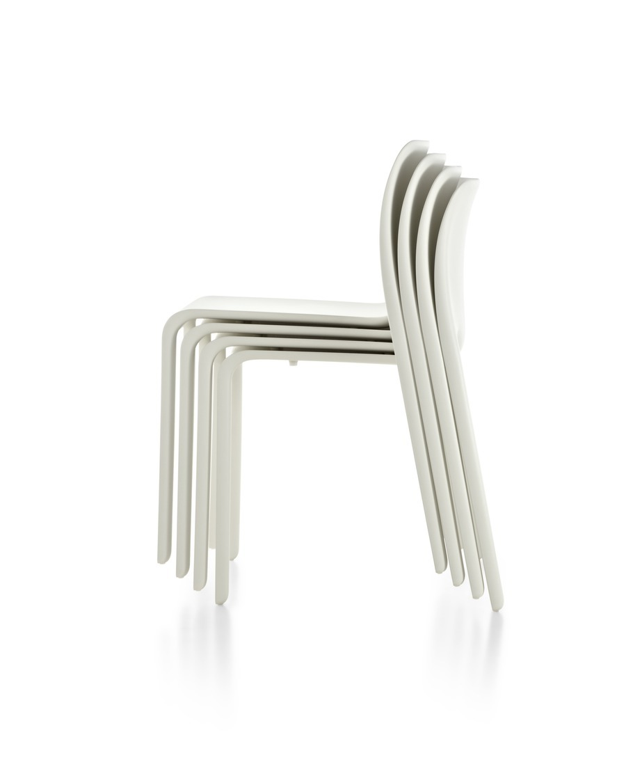 Stack of white Magis Chair First, viewed from the side