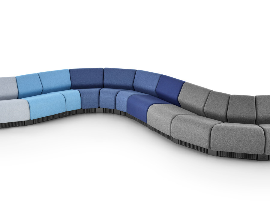 A serpentine seating configuration formed with Chadwick Modular Seating modules in shades of gray and blue.
