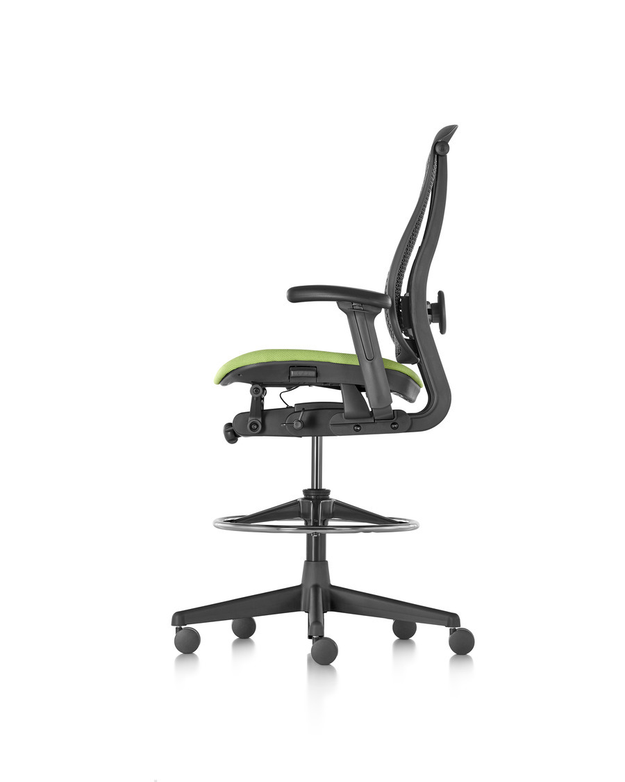 Profile view of black and lime green seat Celle Stool