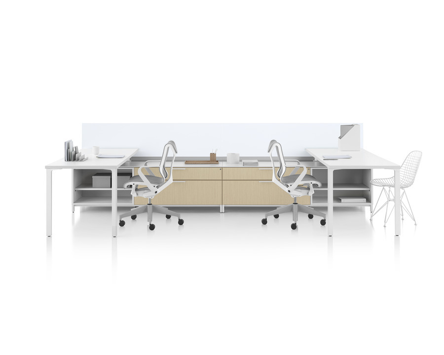 A Canvas Dock workstation with white surfaces, glass screens, and light wood lower storage.
