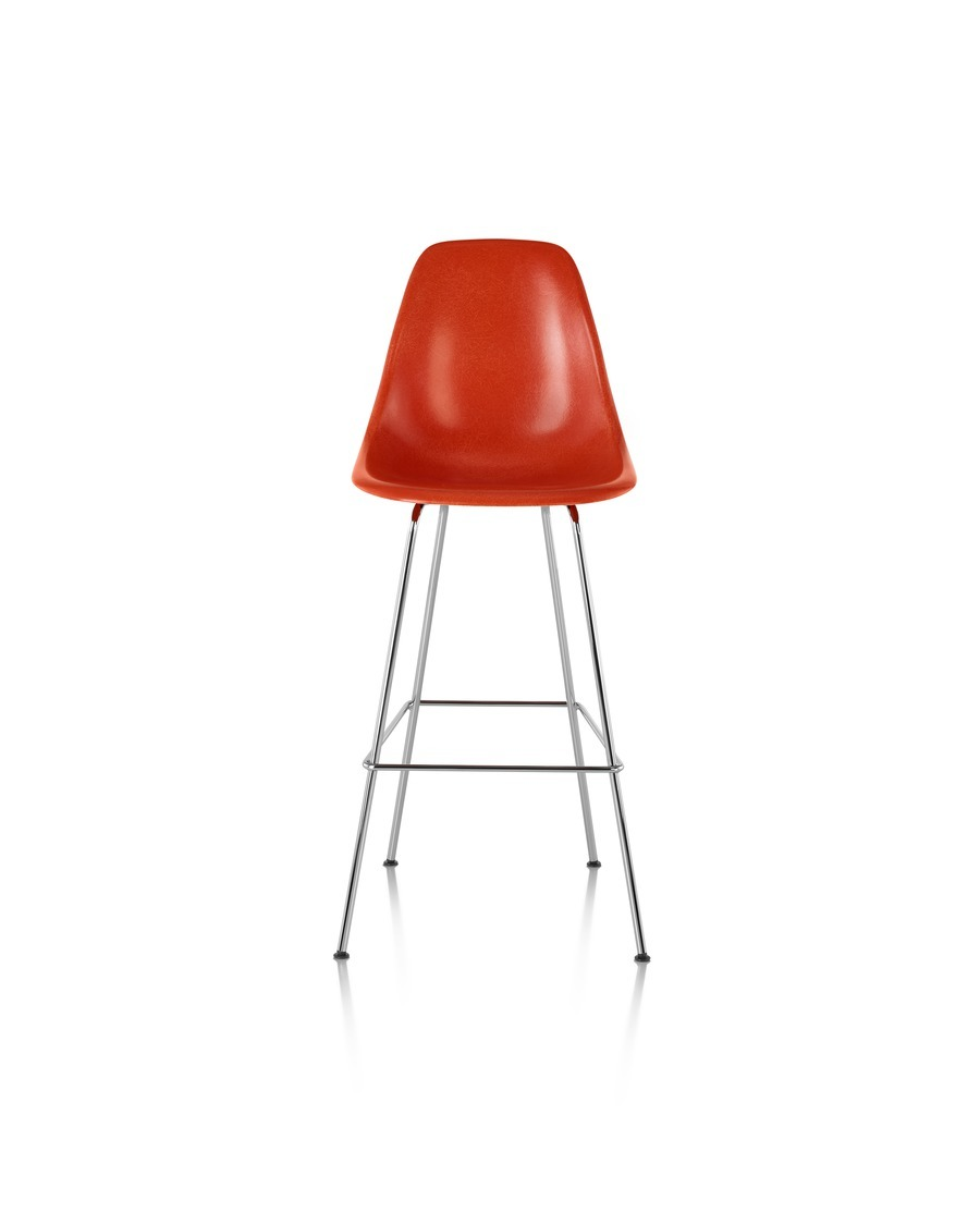 Red Eames Molded Fiberglass Stool, viewed from the front.