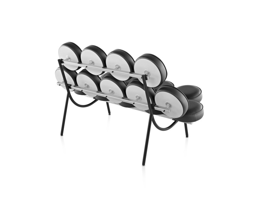 Black leather Nelson Marshmallow Sofa with black satin legs viewed from the rear