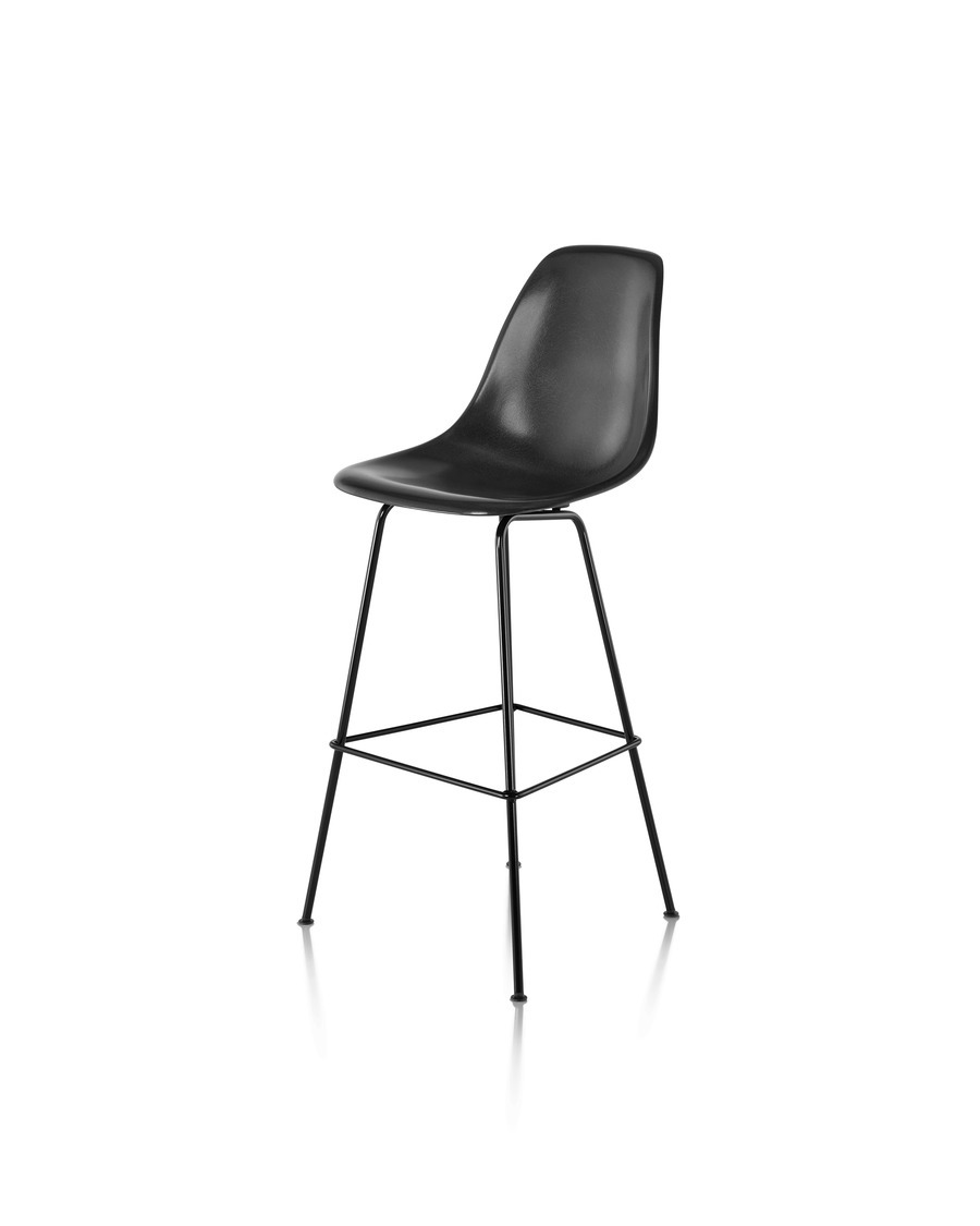 Front angled view of a black Eames Molded Fiberglass Stool.