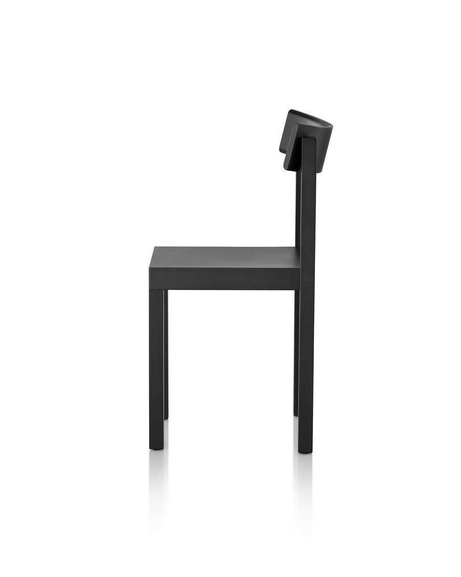 Profile view of a black Mattiazzi Primo stacking chair.