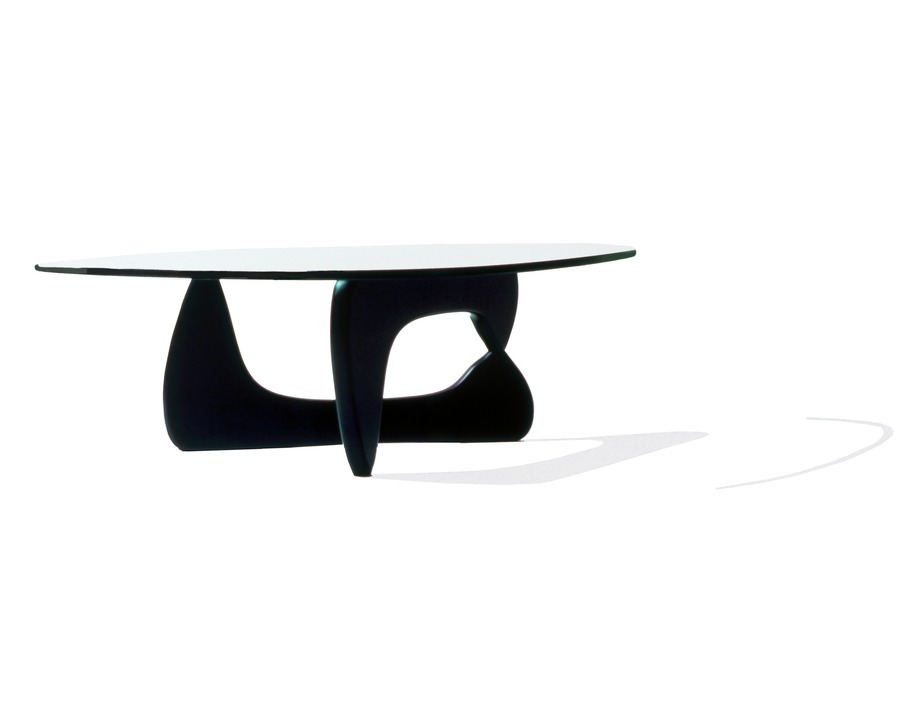 A Noguchi occasional table with a freeform glass top and black base.