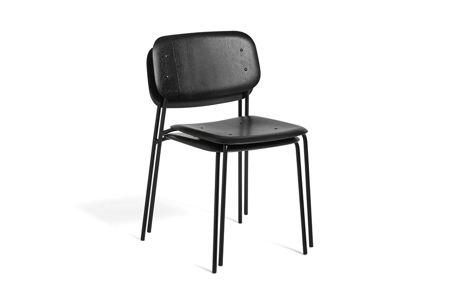 Two black Soft Edge Chairs, stacked, viewed at an angle.