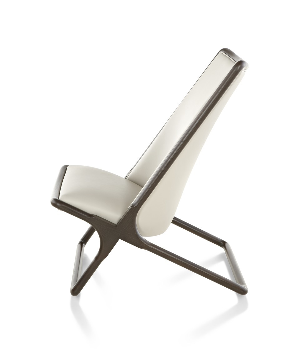 Profile view of cream Scissor Chair with brown frame