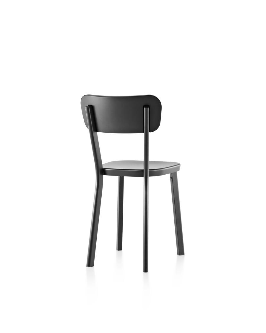 An aluminum Magis Déjà-vu outdoor chair in a black finish, viewed from the rear