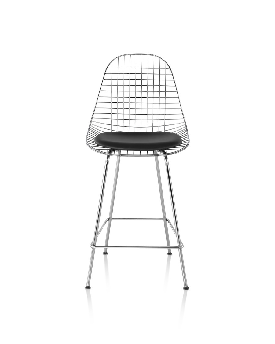 Front view of a silver Eames Wire Stool with a black seat pad.