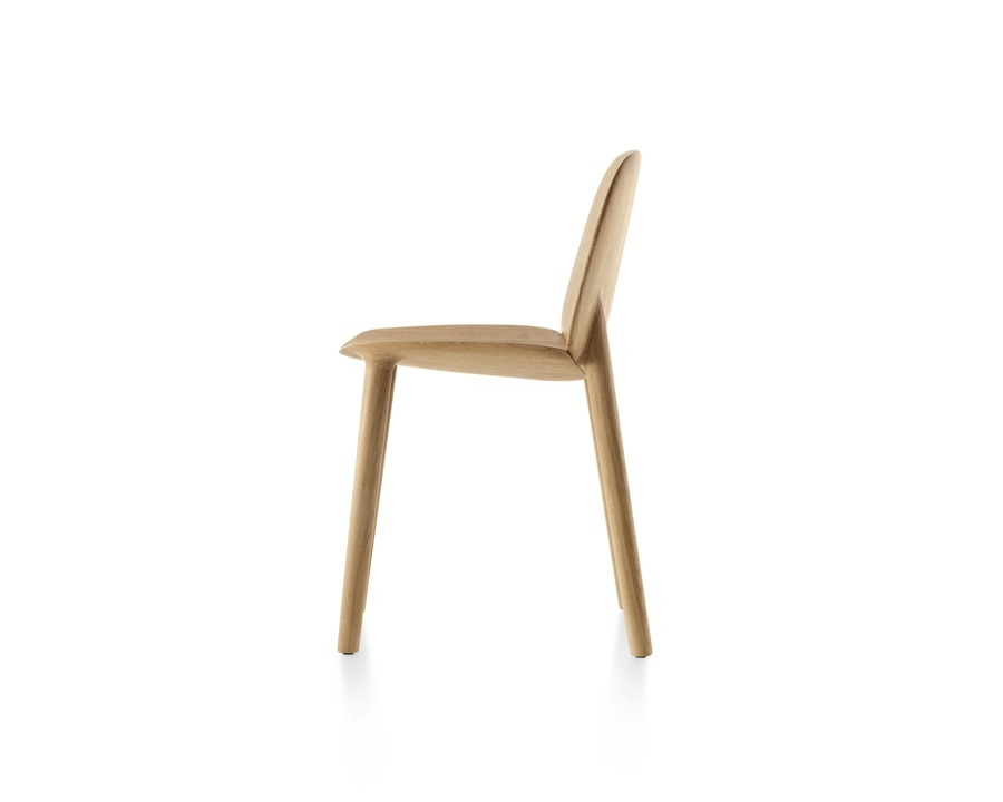 Profile view of a wood Mattiazzi Osso side chair.