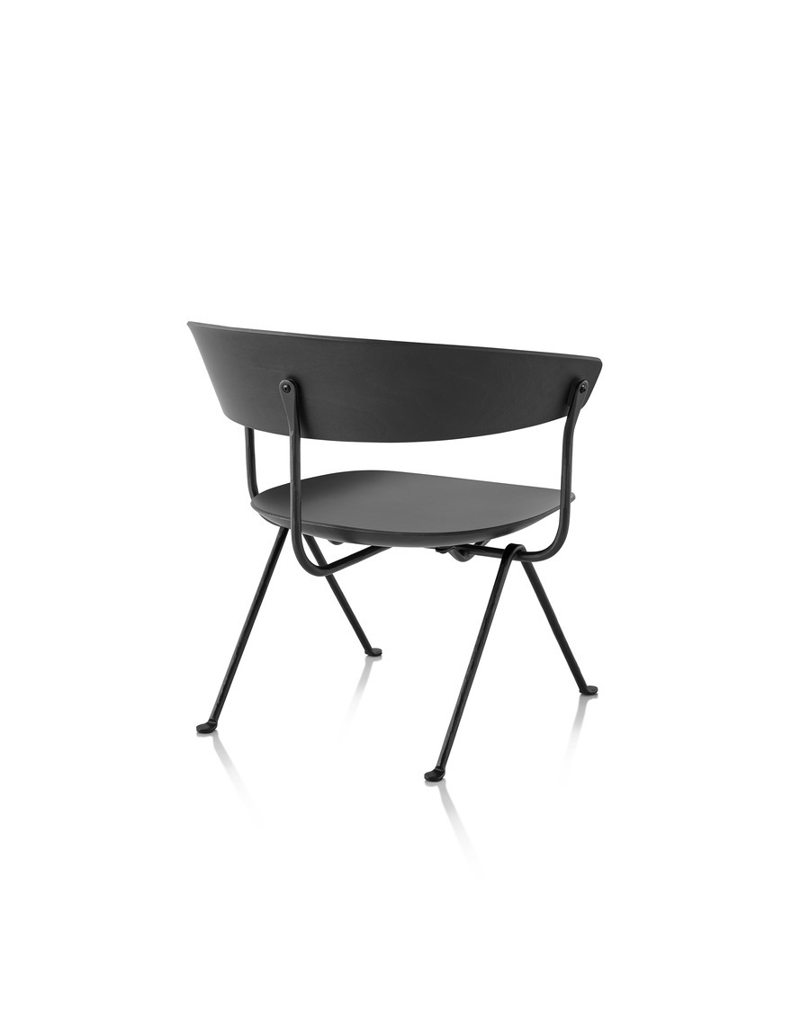Magis Officina Low Chair in black beech with black frame, viewed from the rear at an angle