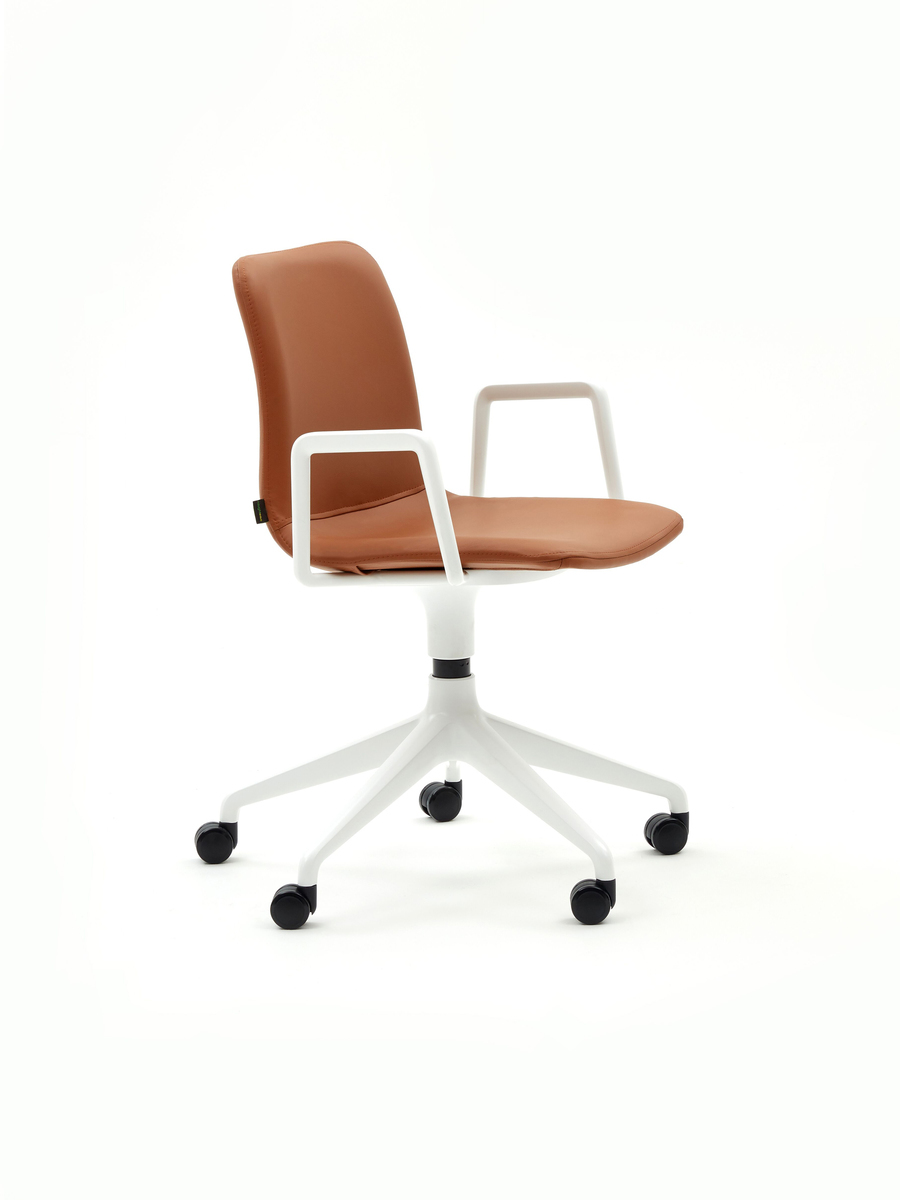 Profile view of a brown leather Viv Desk Chair with white base and armrests on wheels