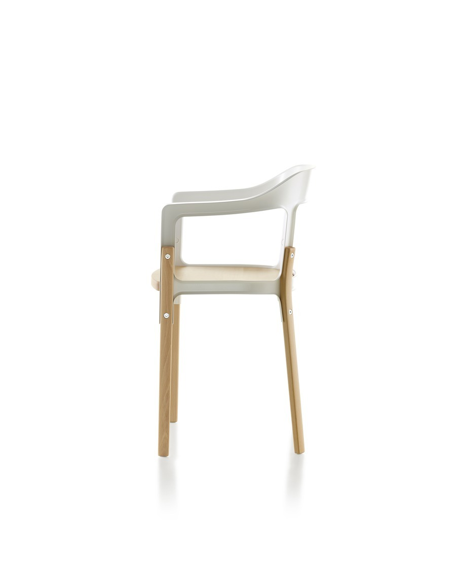 Magis Steelwood Chair, with white back and arms and a natural wood finish on the seat and legs, viewed from the side