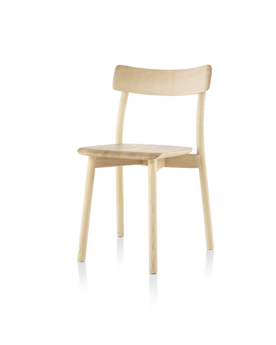 Armless Mattiazzi Chiaro stackable side chair with a light wood finish, viewed from the front at an angle