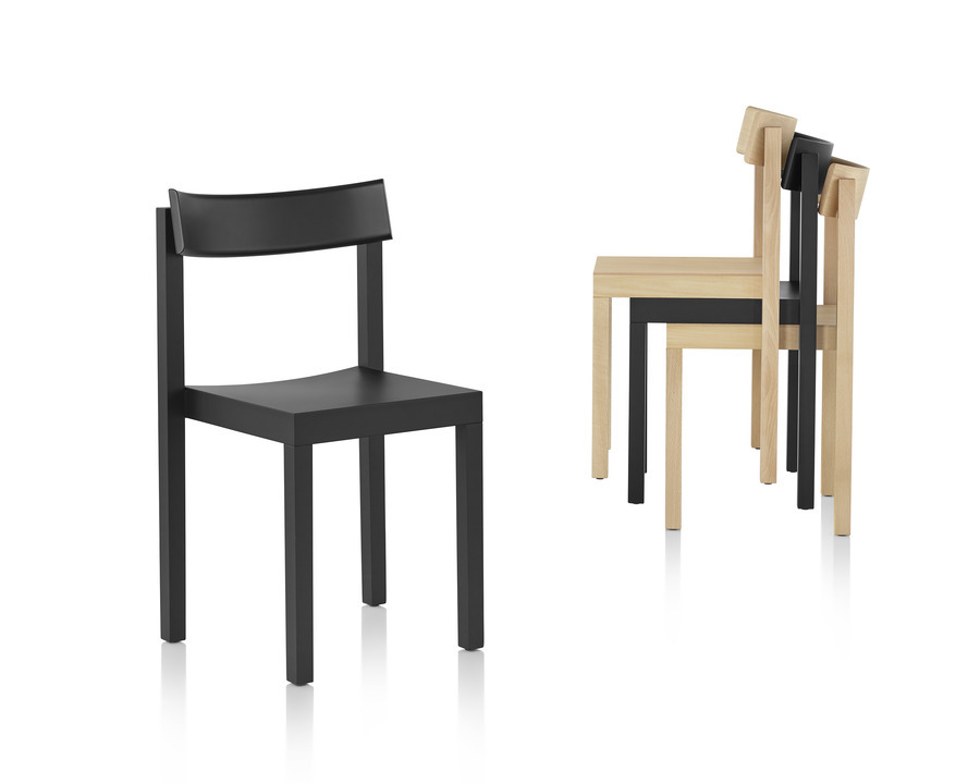Mattiazzi Primo stacking chairs stacked three-high next to a single chair standing alone.
