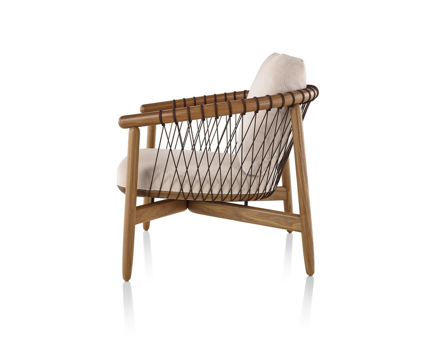 Cream Crosshatch Chair with blonde frame, viewed from the side