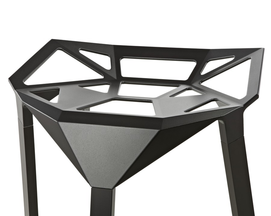 Close up view of the geometric seat of a black Magis Stool_One