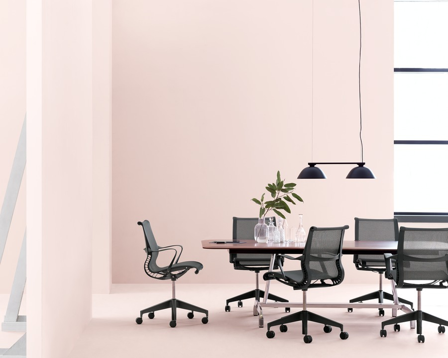 Black Setu office chairs around a conference table from the AGL Table Group.