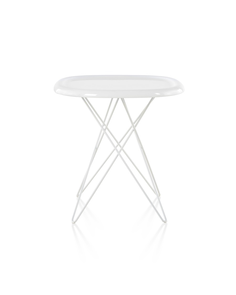 An angled view of a white Magis Pizza occasional table with steel rod legs and an oblong top reminiscent of a pizza