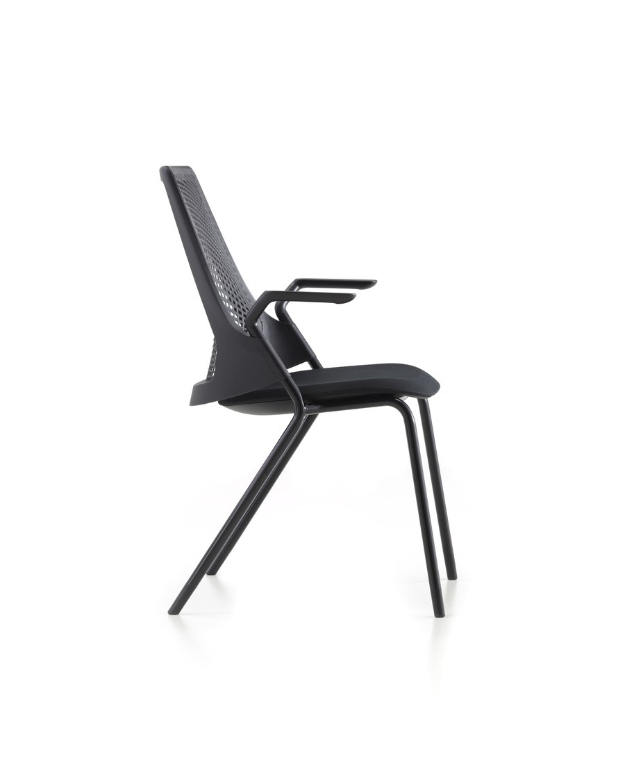 Profile view of the four-leg version of a black Sayl Side Chair.